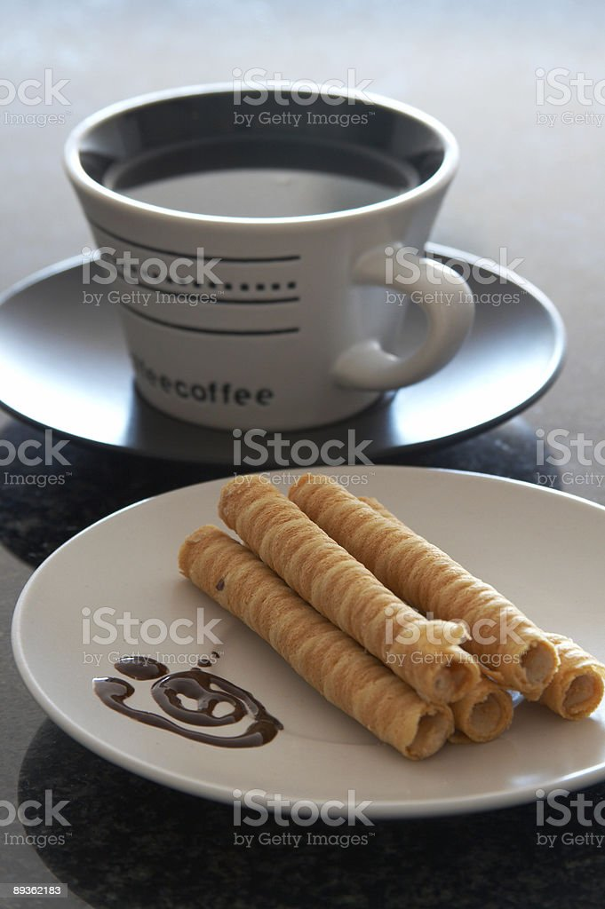 Cup of coffee and cookies on the plate royalty-free stock photo
