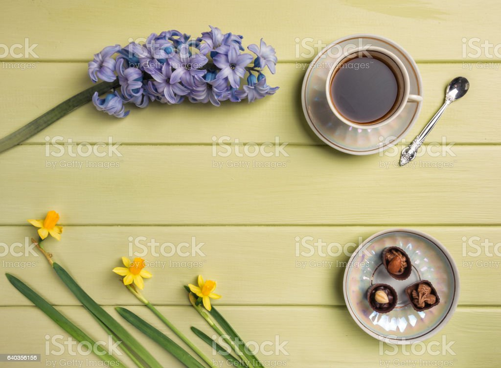 Cup of coffee,  and flowers on a wooden background. stock photo