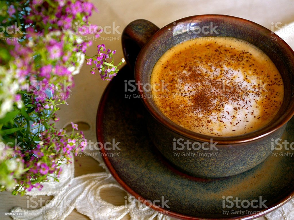 Cup of Coffee and flowers royalty-free stock photo