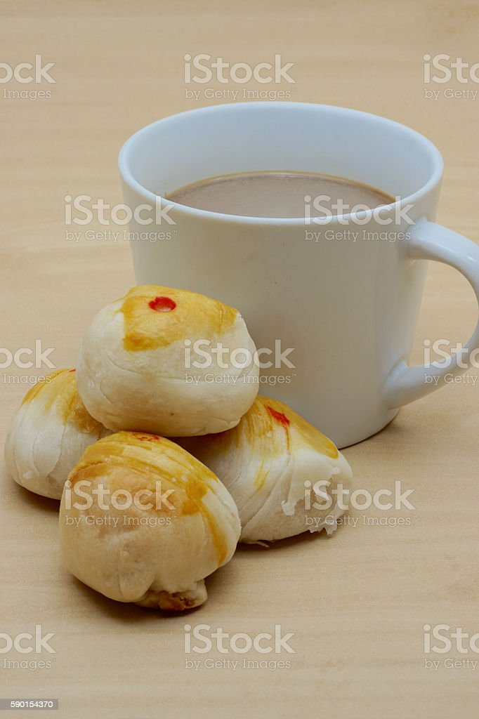 Cup of coffee and four chinese pastry royalty-free stock photo