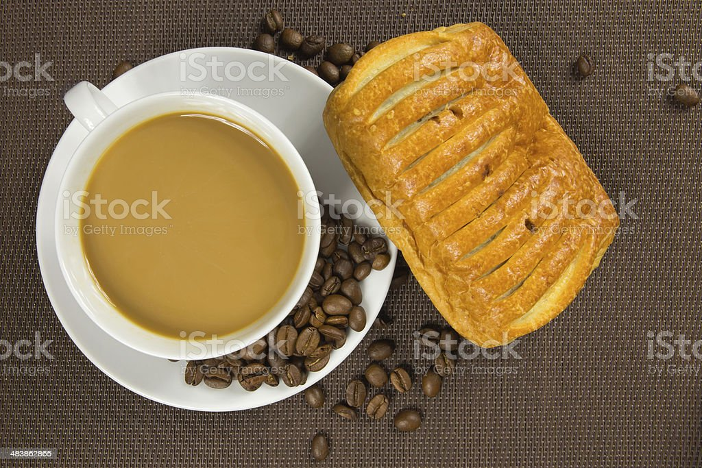 Cup of coffee and french chocolate croissant stock photo