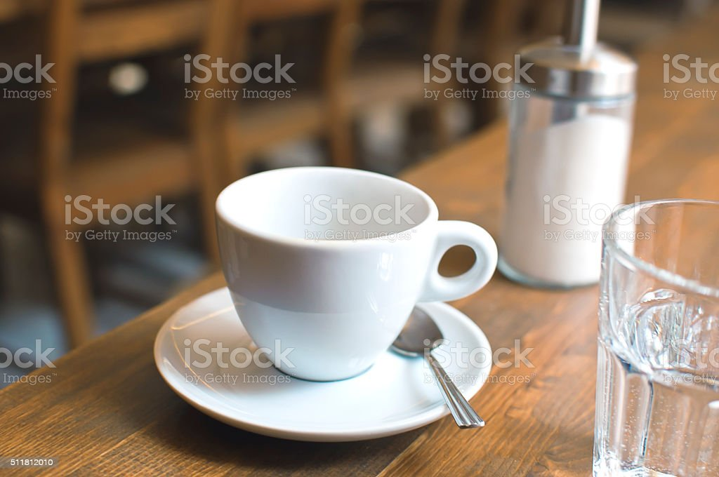 Cup of coffee and glass of water stock photo