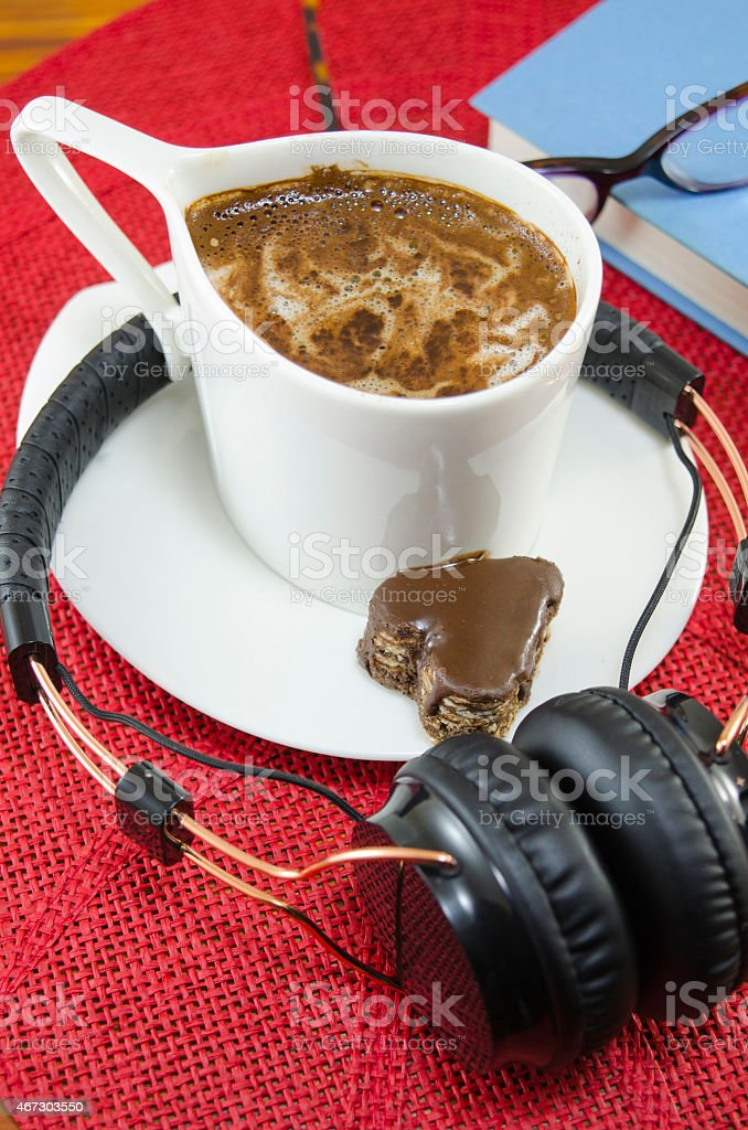 Cup of coffee and headphones royalty-free stock photo