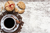 cup of coffee and homemade cookies tied with red ribbon