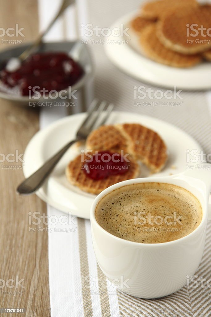 Cup of coffee and mini stroopwafels (syrupwaffles) with jam stock photo