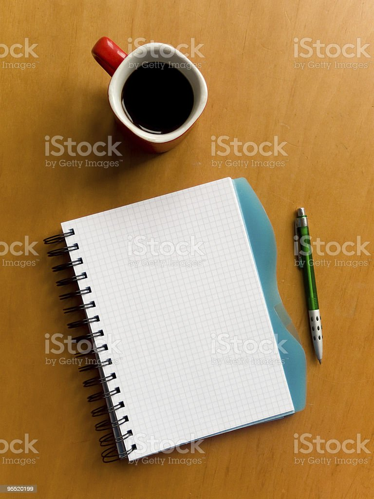 Cup of coffee and notebook royalty-free stock photo