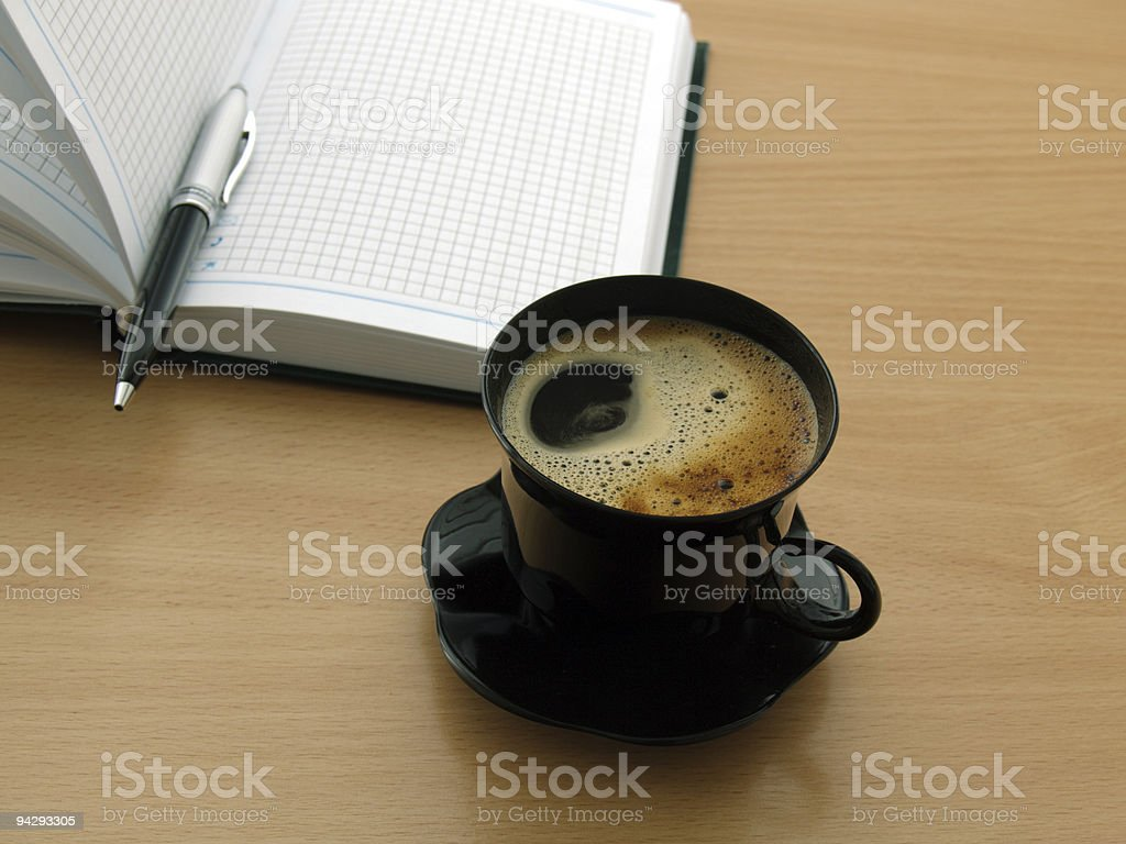 cup of coffee and notepad royalty-free stock photo