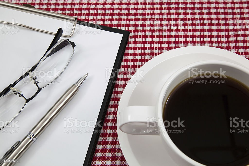 Cup of coffee and paper royalty-free stock photo