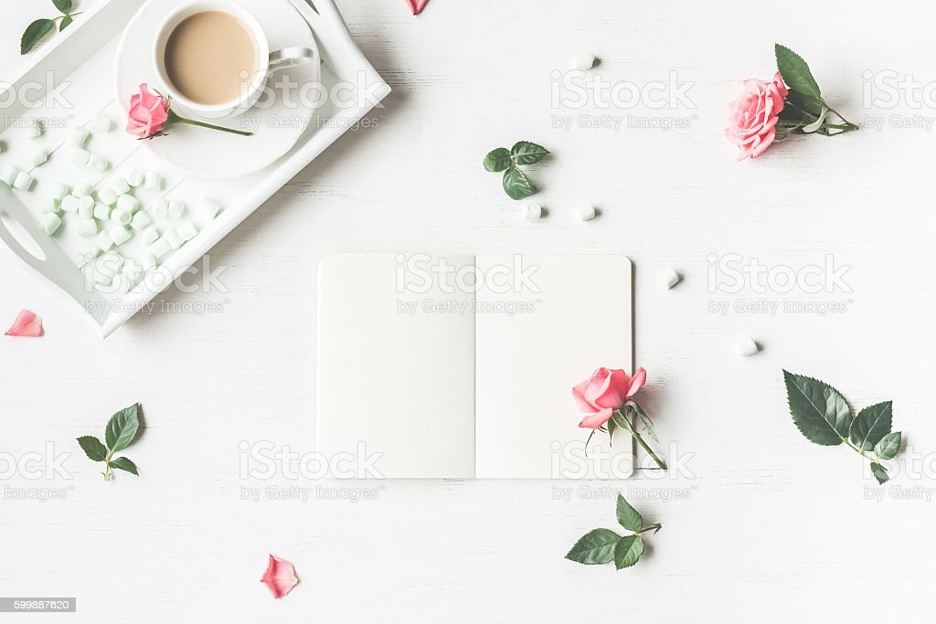Cup of coffee and rose flowers. Flat lay, top view stock photo
