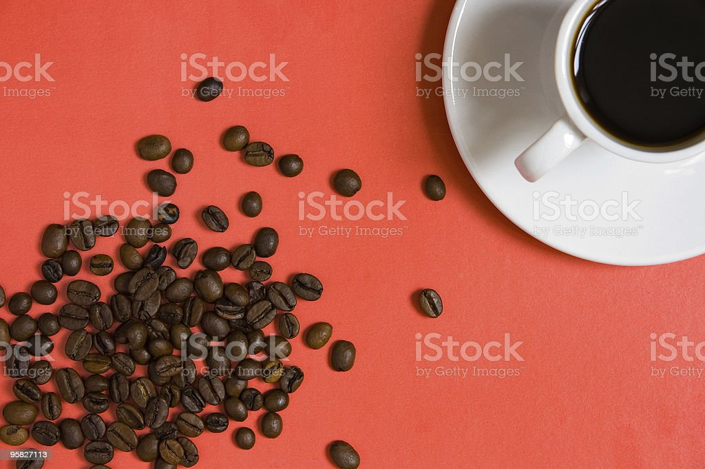 Cup of coffee and spilled beans royalty-free stock photo