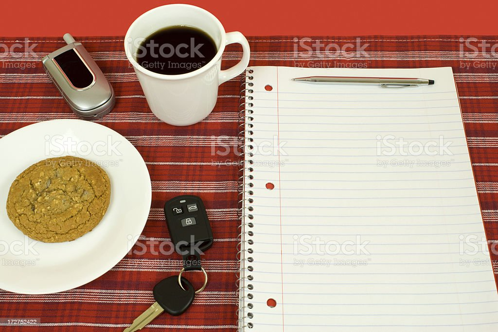 Cup of Coffee and Spiral Notebook on Red Plaid royalty-free stock photo
