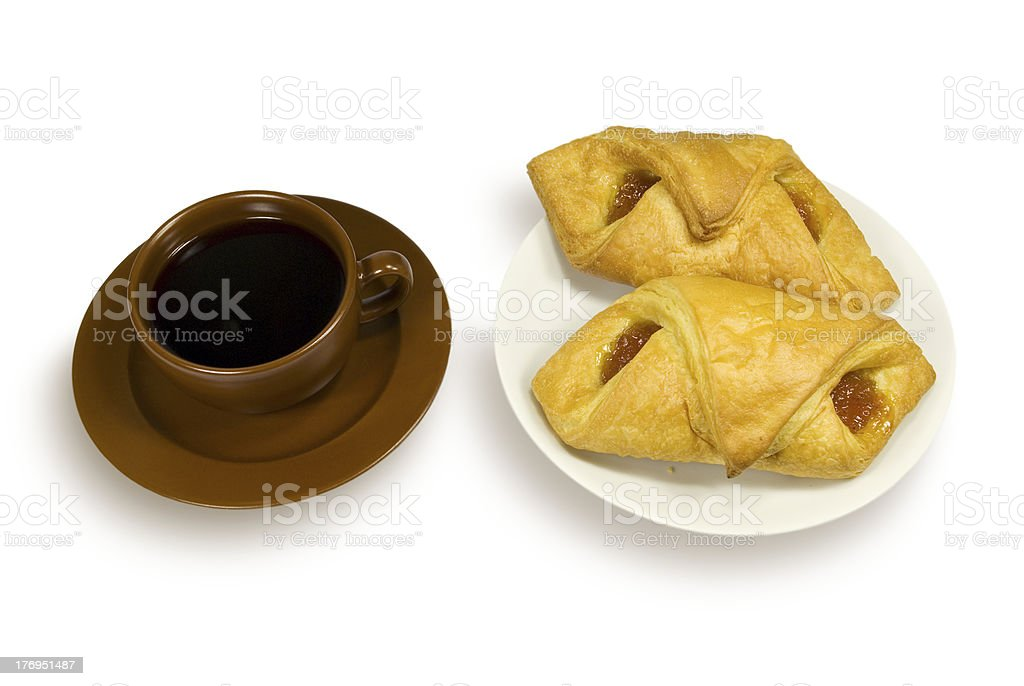 Cup of coffee and two pies on a plate royalty-free stock photo