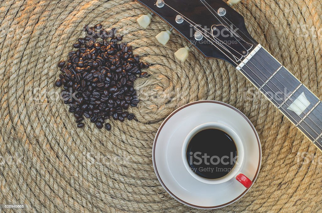 Cup of coffee bean with on a jute rope. stock photo