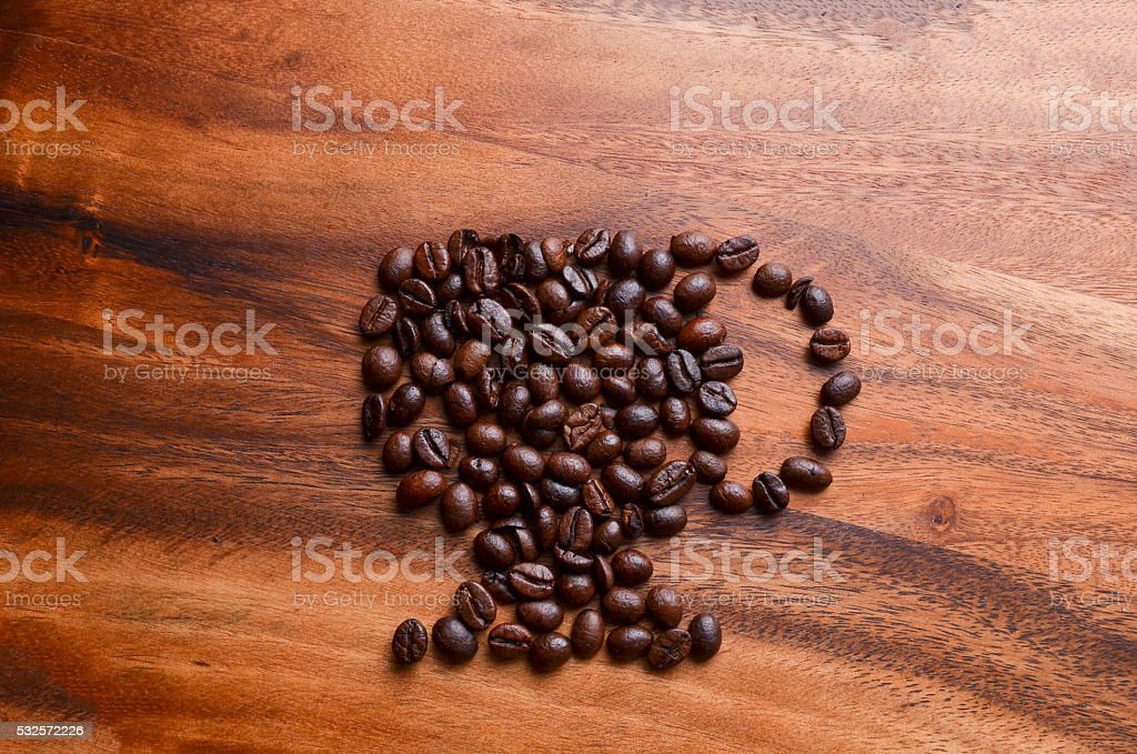cup of coffee beans on wood background stock photo