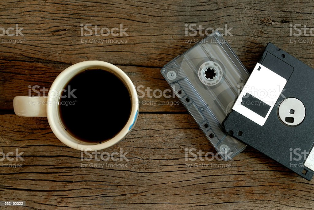 cup of coffee  cassette tape and floppy disk stock photo
