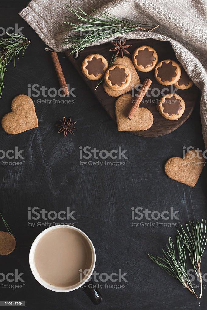 Cup of coffee, christmas gingerbread, pine branch, cinnamon sticks stock photo