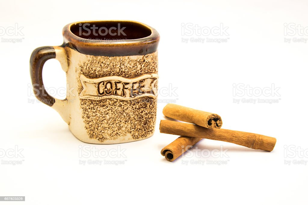 cup of coffee, cinnamon sticks isolated on white background stock photo