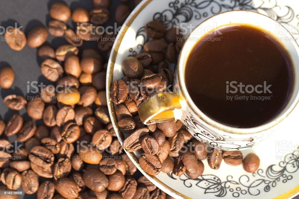Cup of coffee, daylight and grains stock photo