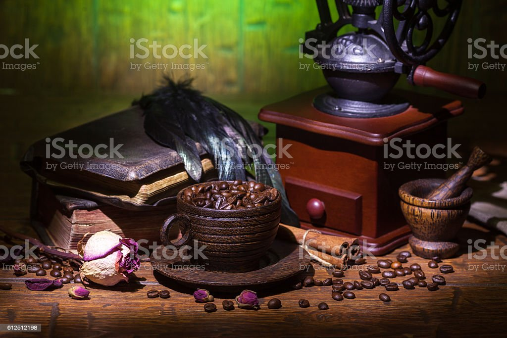 Cup of coffee, dry rose and grinder stock photo