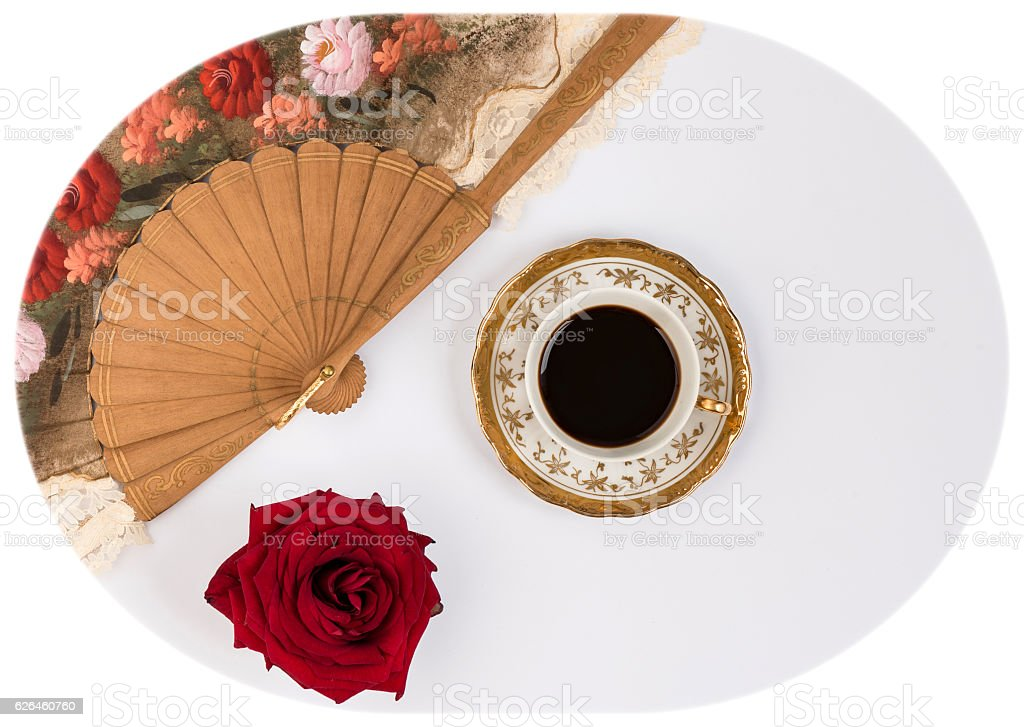 cup of coffee, fan and red rose, relax moment stock photo