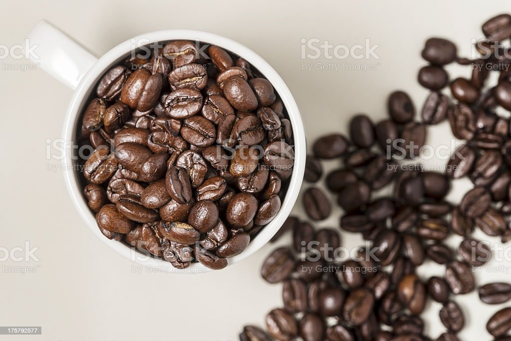Cup of coffee filled with beans royalty-free stock photo