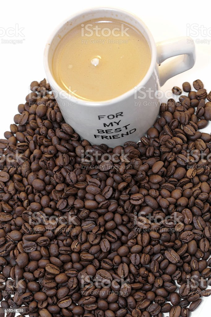 cup of coffee in beans isolated on white royalty-free stock photo