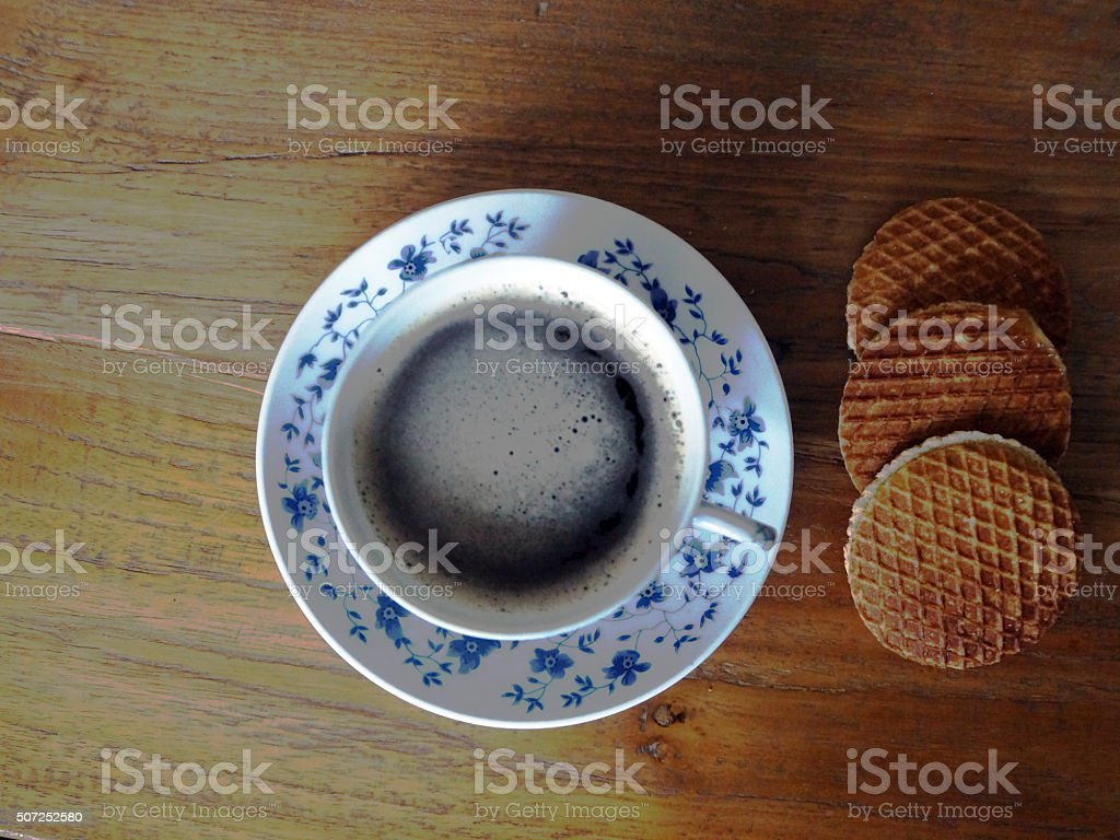 Cup of coffee in Delfts blue cup stock photo