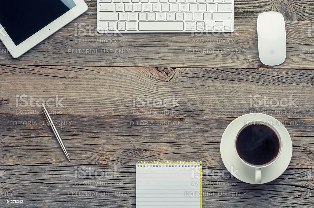 Cup of coffee, keyboard and digital tablet on wooden table. stock photo
