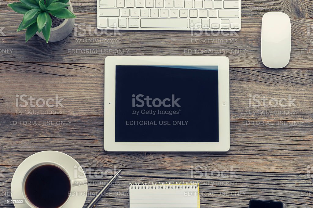 Cup of coffee , keyboard and digital tablet on wooden table. stock photo