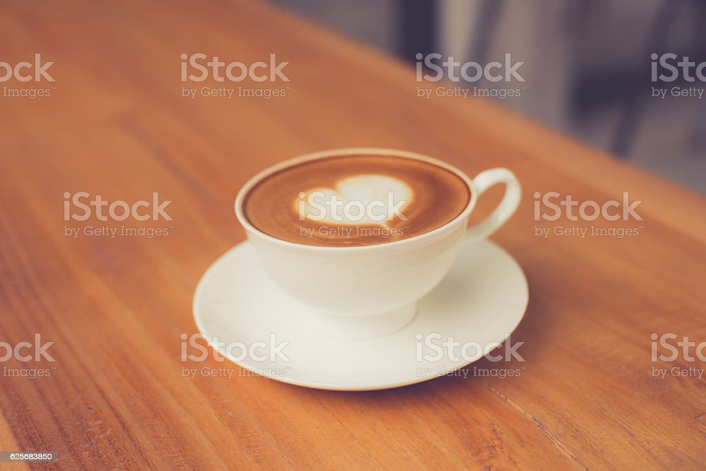 A cup of coffee latte made with vintage filter. stock photo