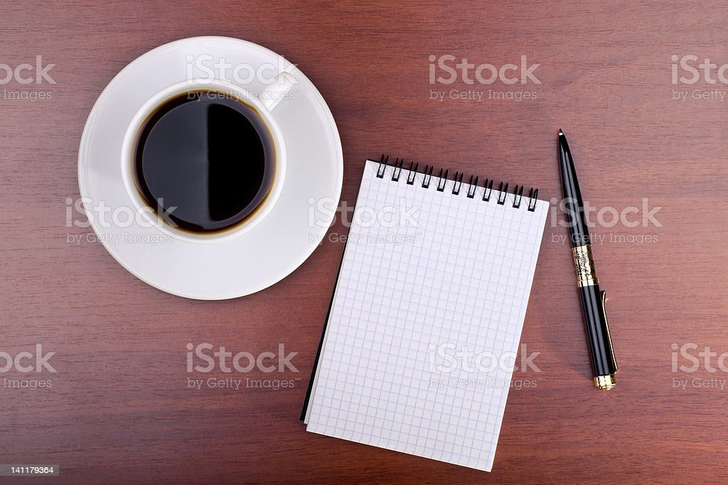 Cup of coffee, notebook and pen royalty-free stock photo