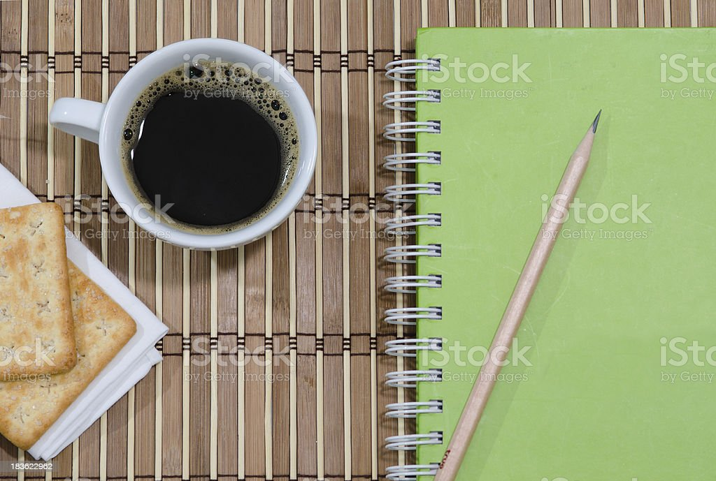 cup of coffee notebook with stock photo