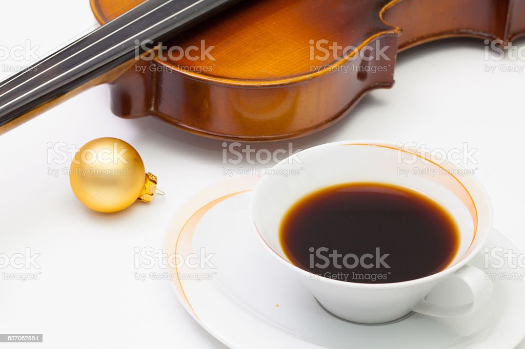Cup of coffee, old violin and Christmas decoration stock photo
