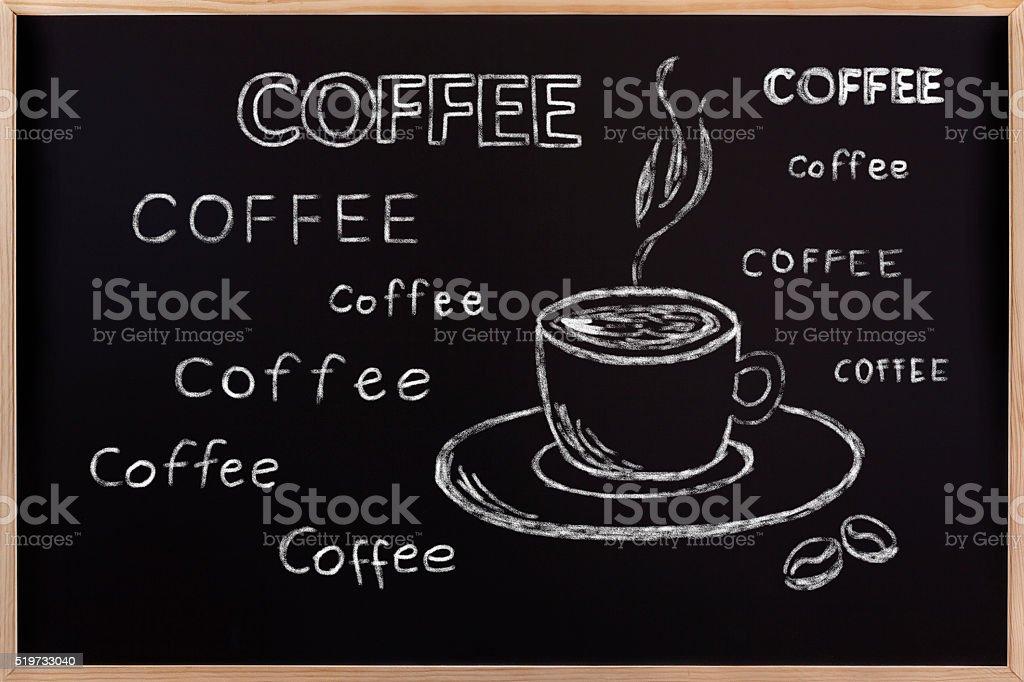 Cup of coffee on a blackboard stock photo