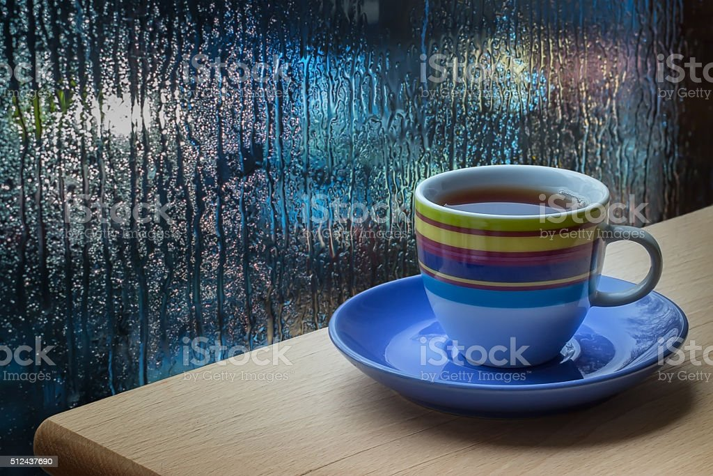 Cup of coffee on a window sill. stock photo