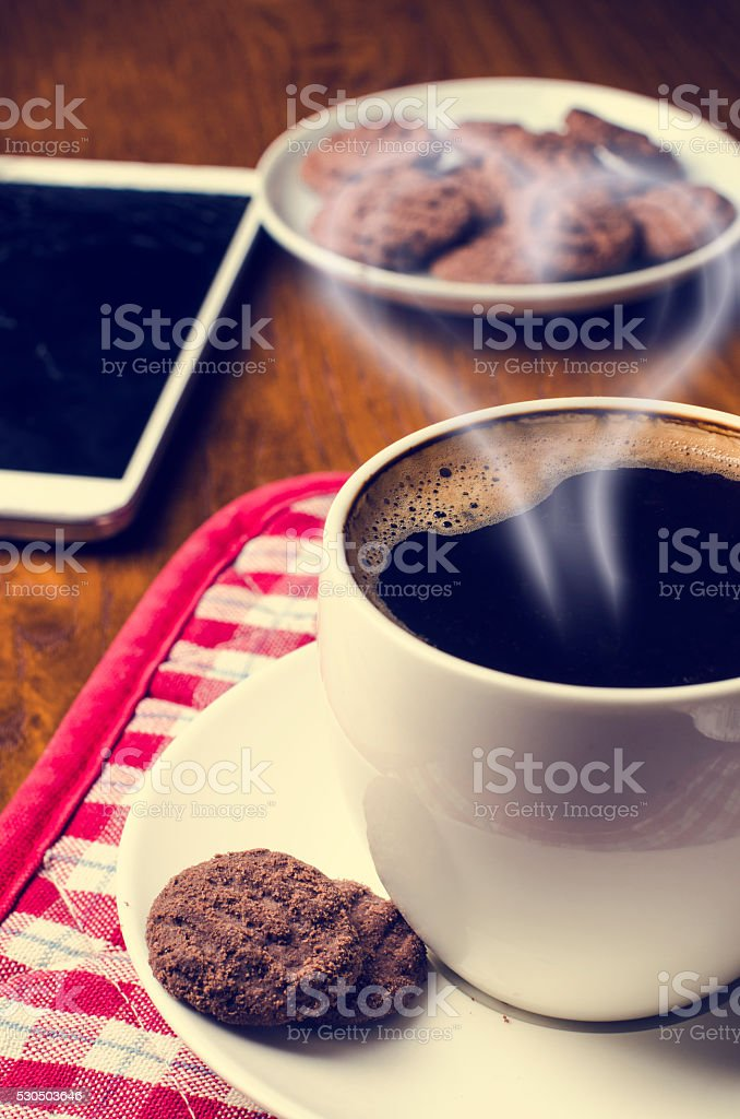 Cup of coffee on a wooden background stock photo