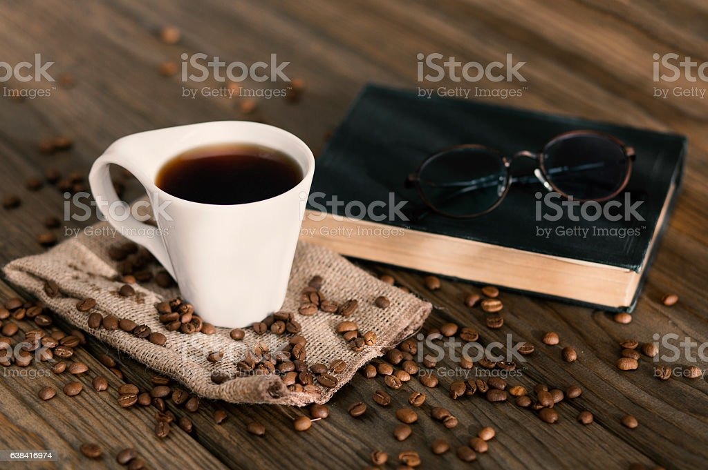 Cup of coffee on a wooden table stock photo