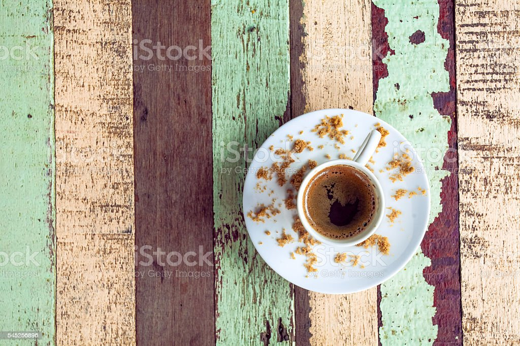 Cup of coffee on an old peel color wooden table stock photo