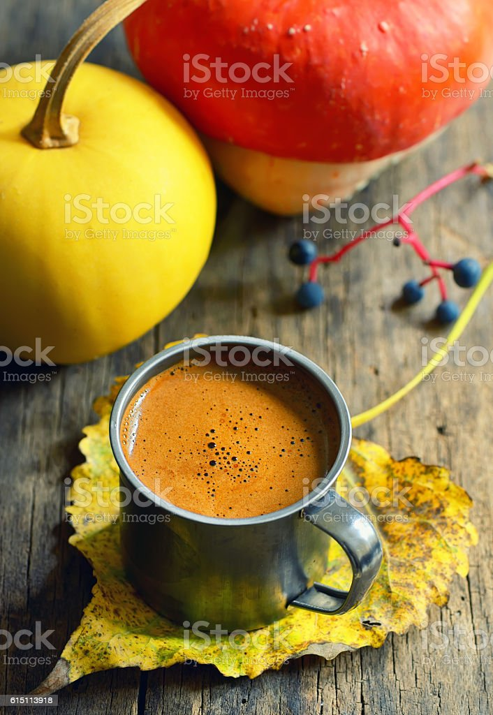 Cup of coffee on autumn leaf stock photo