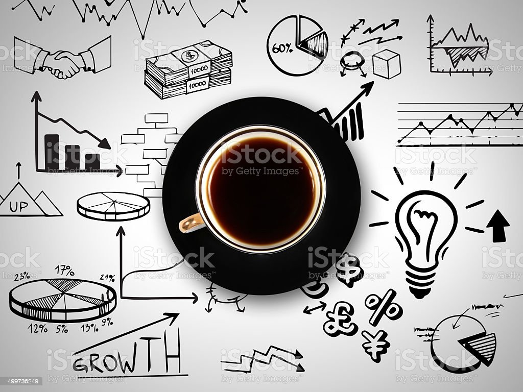 cup of coffee on background of business strategy stock photo