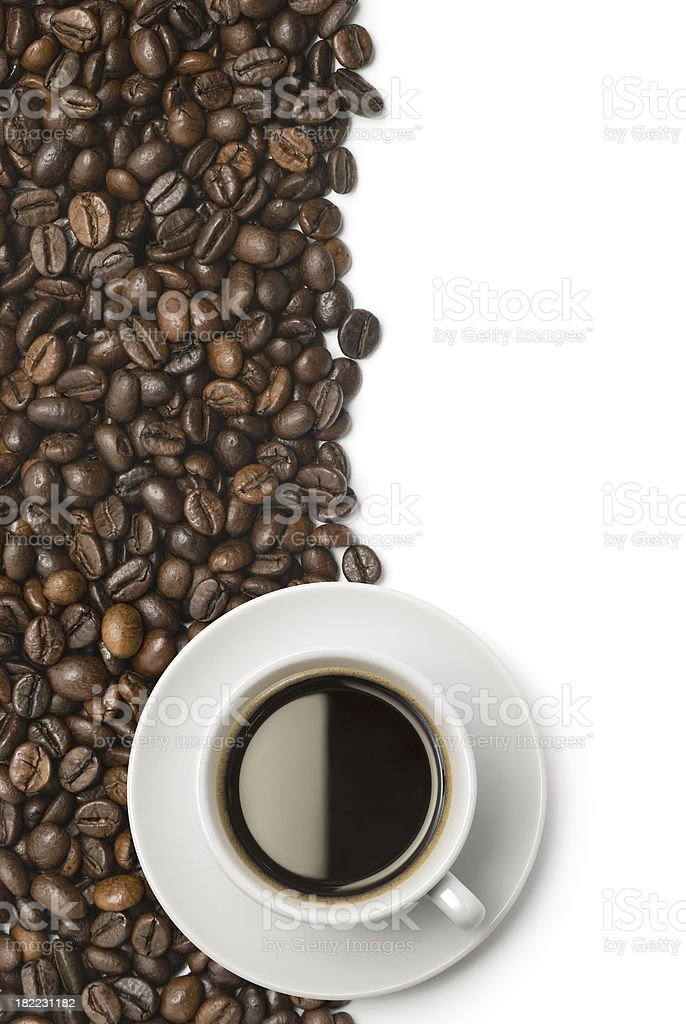 Cup of coffee on beans royalty-free stock photo