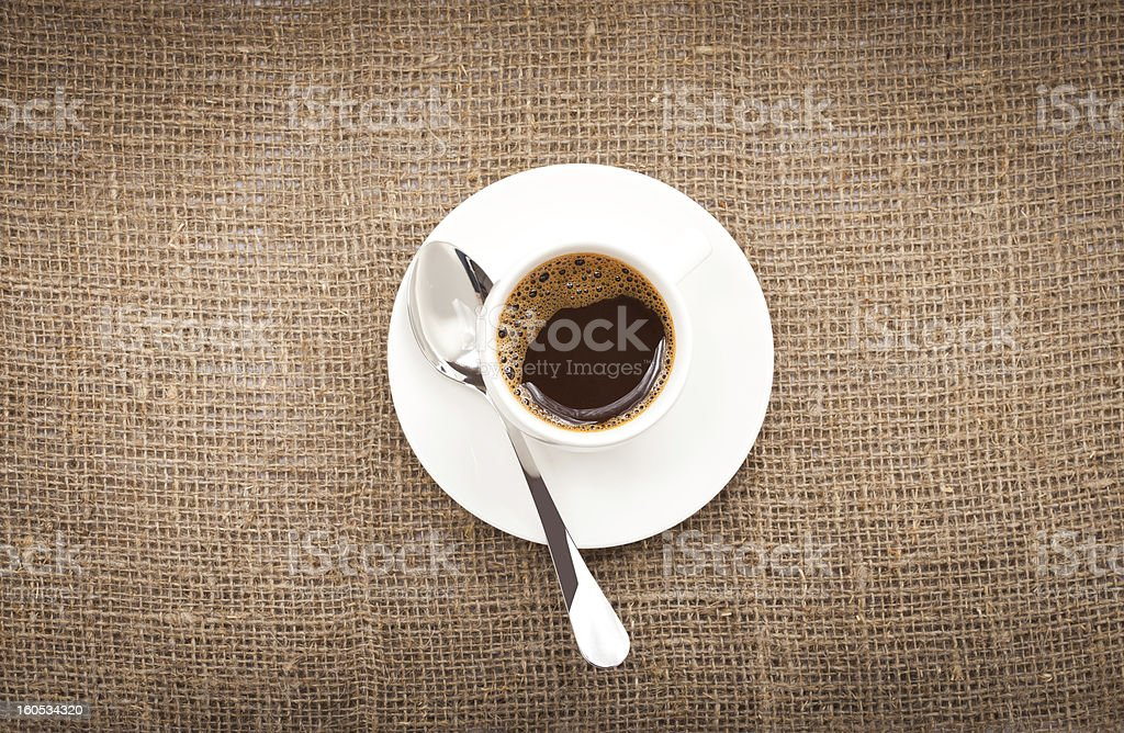 cup of coffee on burlap background royalty-free stock photo