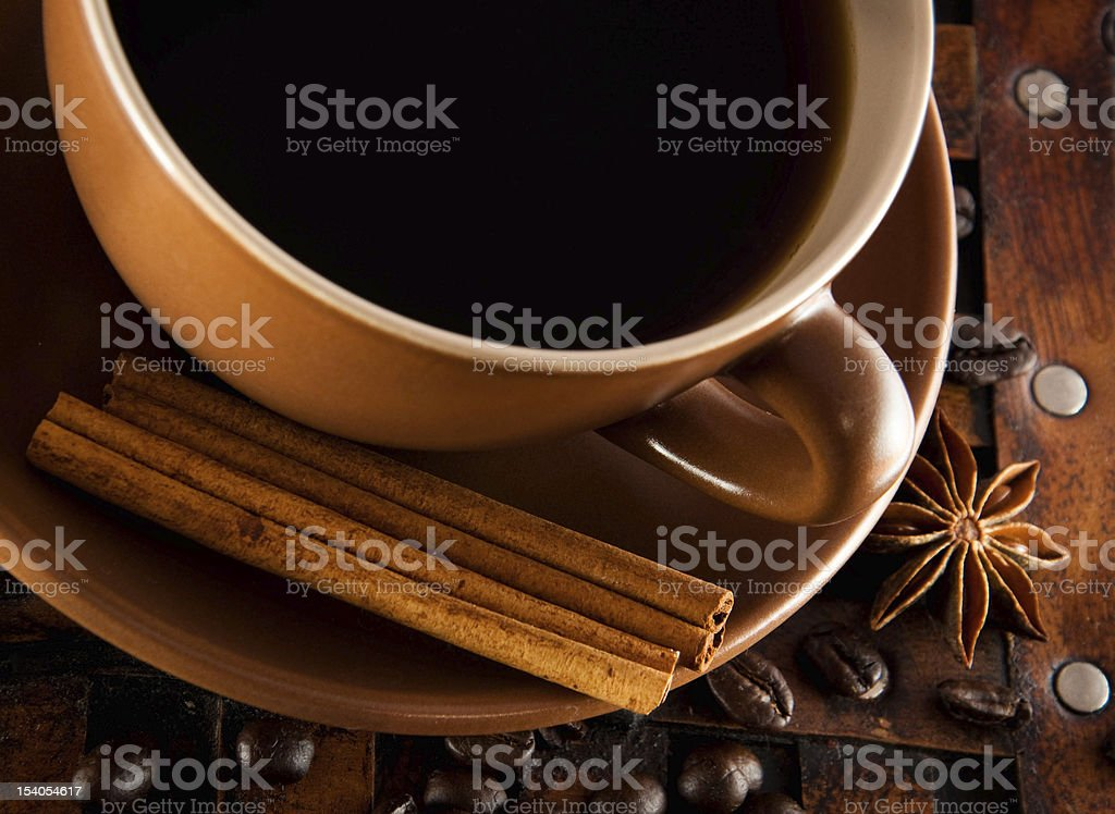 Cup of coffee on grange a background royalty-free stock photo