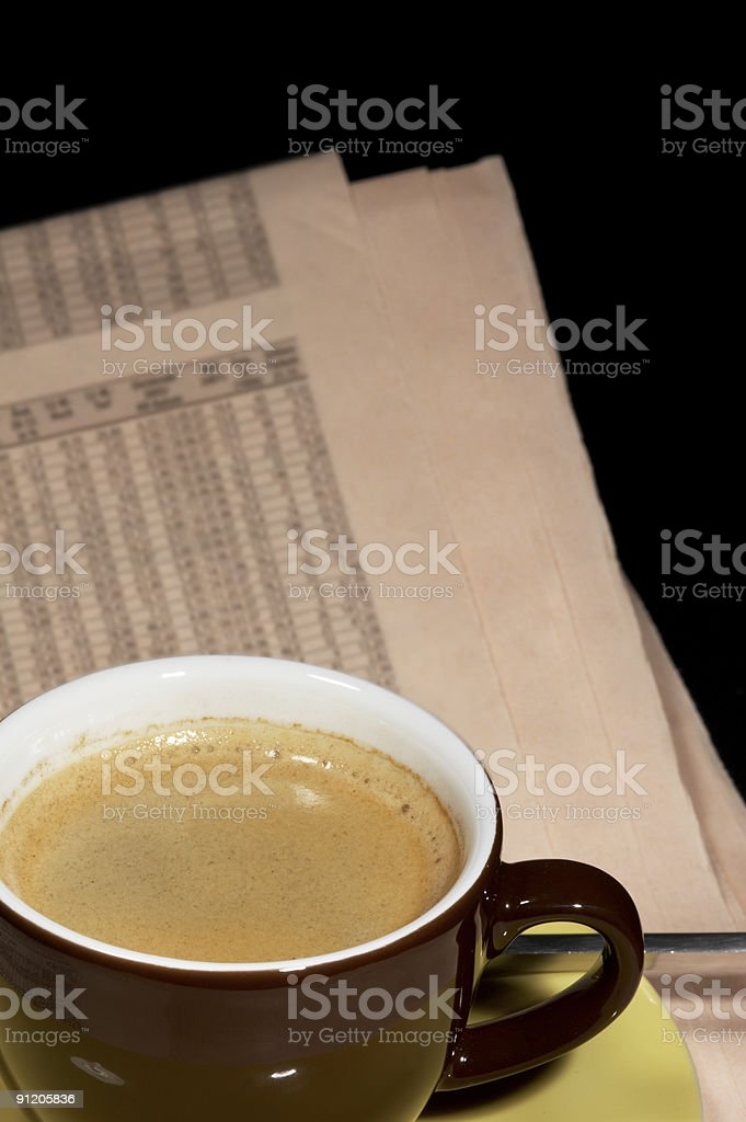 cup of coffee on newspaper royalty-free stock photo