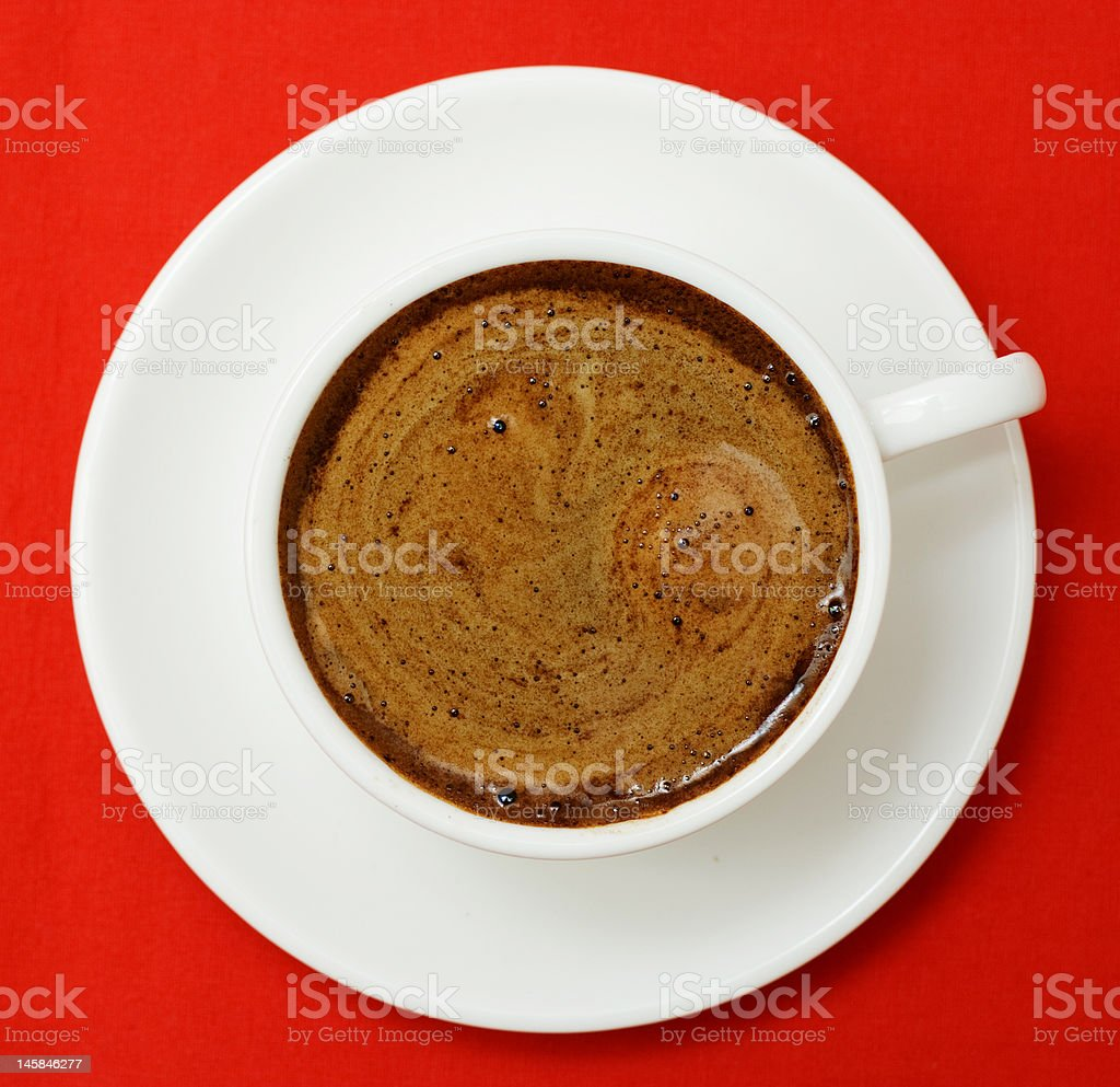 Cup of coffee on red. royalty-free stock photo
