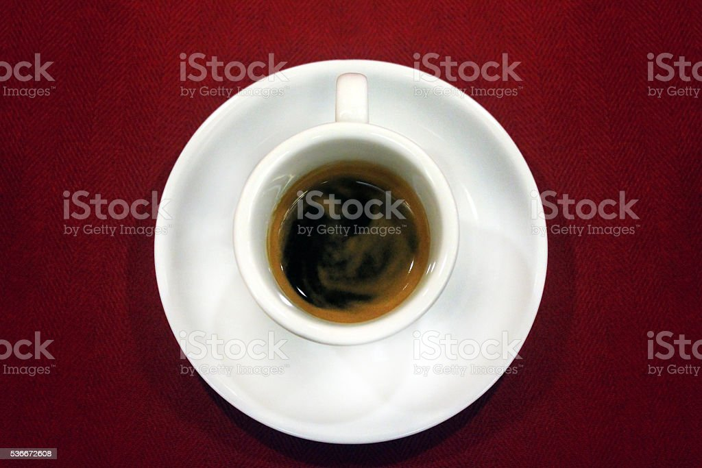 cup of coffee on red tablecloth stock photo