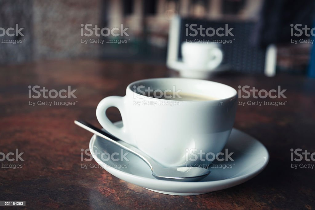 Cup of coffee on rustic table stock photo