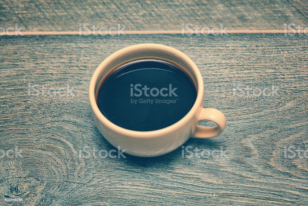 cup of coffee on the old wooden table stock photo