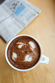 cup of coffee on the table with newspaper