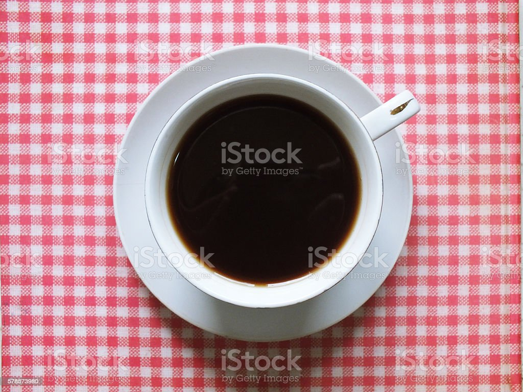 cup of coffee on the tablecloth stock photo